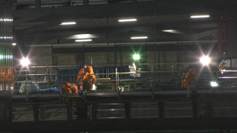 Night shift. Workers at the construction site Footage