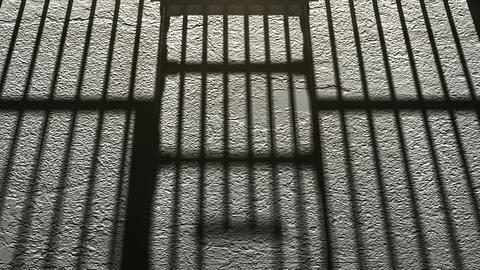 The shadow of prison bars. The door closes Archivo