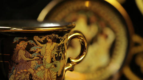 Hot aromatic coffee in a beautiful gold cup ビデオ
