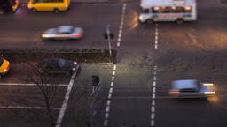 Night footage of people crossing road using a tilt shift effect Footage