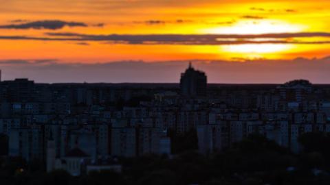 Evening in the city, light up lights, lights of houses. Timelapse, tilt shift Footage
