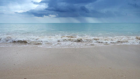 White sandy beach on background of stormy sky Footage