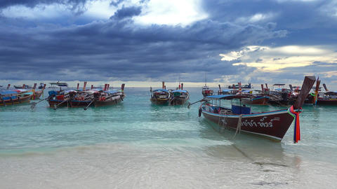 Long tail boats at beach and storm clouds Footage