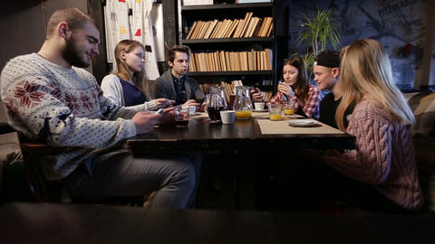 Gen z. Young friends using smart phones in cafe Live Action