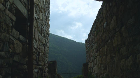 Medieval Stone Castle Walls Stand among High Mountains Footage