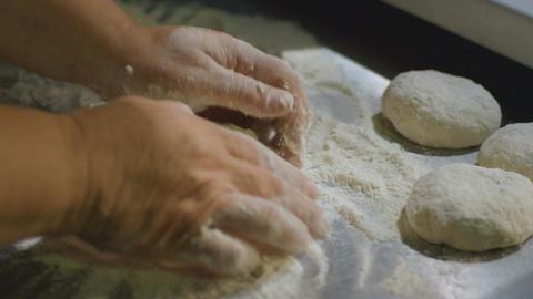Closeup Human Hands Knead Dough on Board with Flour ライブ動画