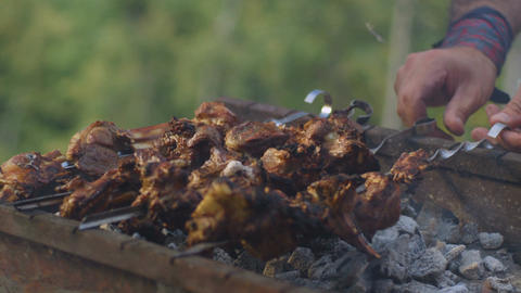 Close Slow Motion Hands Turn Over Kebabs Skewers in Grill Smoke Footage
