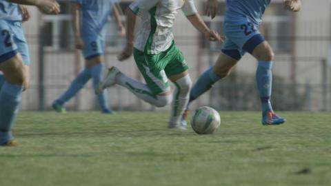 Two Football Teams Play Football on Green Stadium Field Footage