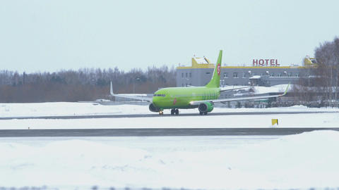 Boeing 737-800 taxis to runway at Tolmachevo Airport in winter Footage