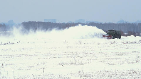 Snowblower works on snowy field Footage