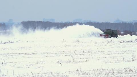 Snowblower works on snowy field Footage