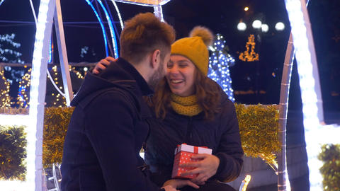 Lovers exchanging Christmas presents at Christmas fair Footage