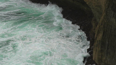 Ocean waves and a rocky shore Footage