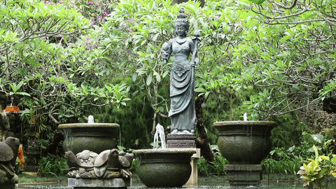 Pond and statue in a garden Footage