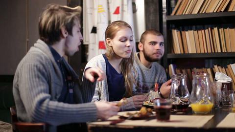 Group of teenagers sharing meal together in cafe Footage