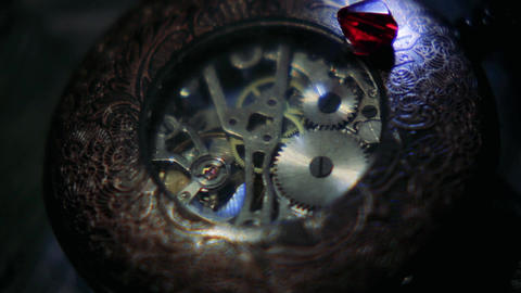 Cogs turning inside of an old-fashioned pocket watch Footage