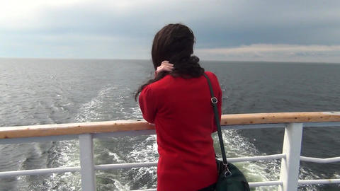 Girl standing on the ship Footage