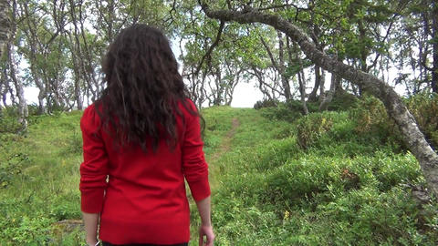Woman walking alone in forest Footage