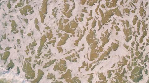 Aerial View Landing on Surface Ocean Footage