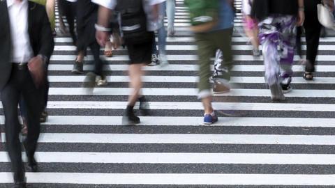 People walking on a pedestrian crossing (time lapse / low speed shutter) Footage