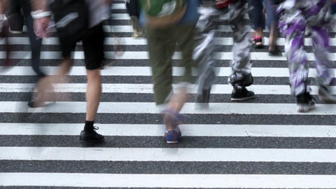 People walking on a pedestrian crossing (time lapse / low speed shutter) / pan Footage