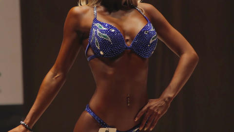 Female bodies of beautiful feminine woman and super-ripped muscular bodybuilders Live Action