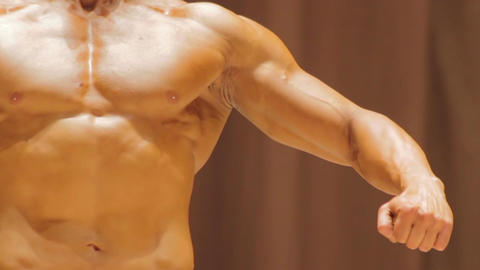 Powerful man with strong masculine arms and muscular torso, bodybuilding contest Live Action