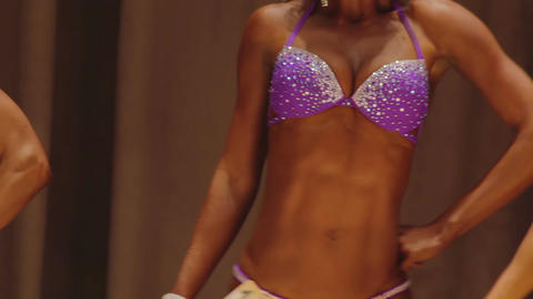 Lady demonstrating perfect fit body in sparkling glamorous swimwear at contest Footage