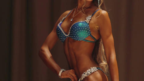Tanned fitness model demonstrating perfect fit body, enduring self-improvement Live Action