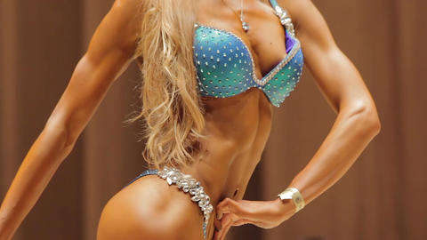 Sexy body of strong female bodybuilder posing in bikini, fitness competition Footage