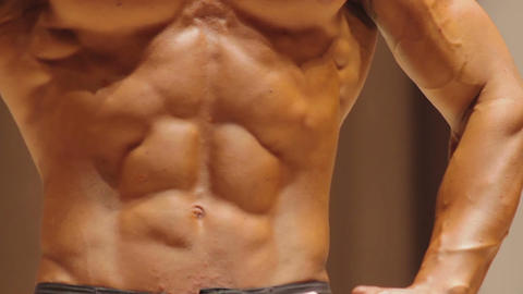Perfect six-pack abs and muscular torso of strong bodybuilder, ideal masculinity Live Action