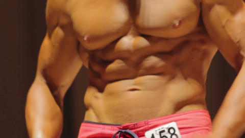 Annoyed bodybuilder disappointed with competition results, arguing with jury Live Action