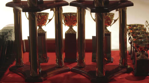 Prizes for victory in competition, achieve success, golden cups for winners Footage