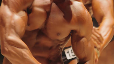 Massive ripped muscles of men obsessed with bodybuilding, fitness contest Live Action