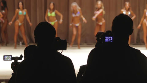 Beautiful ladies in glamorous bikini taking seductive poses, posing to cameramen Footage
