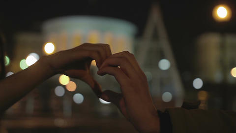 Male and female hands making heart shape sign, romantic story of eternal love Footage
