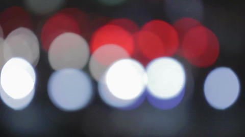 Defocused traffic lights moving on night city road, abstract street background Footage