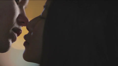 Young woman giving boyfriend a farewell kiss, romantic date, first love story Live Action
