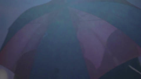 Young couple enjoying weekend, walking under umbrella, romantic evening Footage
