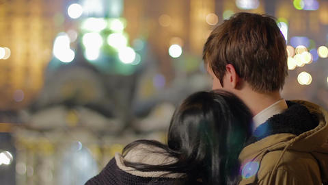 Young couple enjoying romantic date, hugging, looking into future together Footage