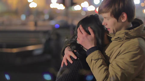 Young couple hugging and kissing on the street, romantic date, first true love Footage