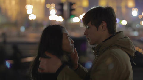 Romantic couple kissing on street in city center, tenderness, first love, dating Live Action
