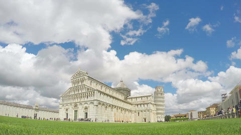 Beautiful white clouds flying above Pisa cathedral and leaning tower in Italy Footage
