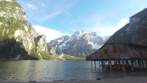 Pragser Wildsee surrounded by mountains, timelapse of clouds above lake water Footage
