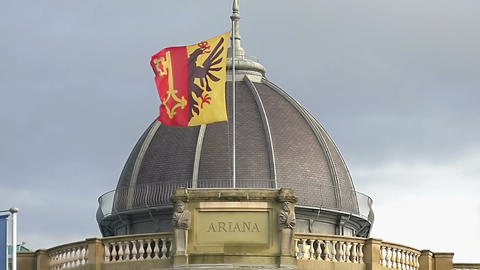 Geneva flag on Musee Ariana roof, Swiss Museum of Ceramics and Glass, slow-mo Live Action
