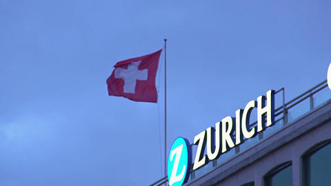 Swiss national flag flapping on top of building in Zurich, travel to Switzerland Footage