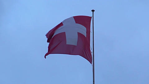 National flag of Switzerland flying in wind against sky background, state symbol Footage