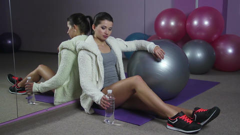 Female fitness trainer having rest in gym, drinking water for body wellness Footage