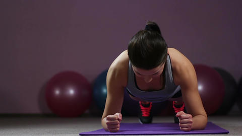 Sportive woman performing plank, finishes exercising in gym, healthy lifestyle Live Action