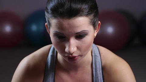 Young woman sweating during intensive workout in gym, doing push-up exercise Footage
